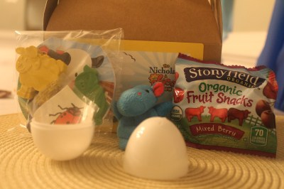 Favors: barn crayons and notepad, animal finger puppet, cow fruit snacks and tattoo inside of plastic egg