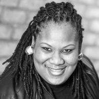Asha DeSuza, Board Member