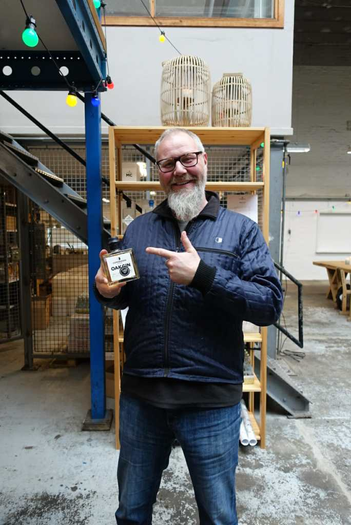 Master distiller Henrik Brinks holding his award winning Oak Gin