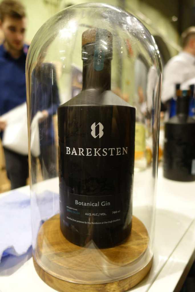 Bareksten gin under a glass dome