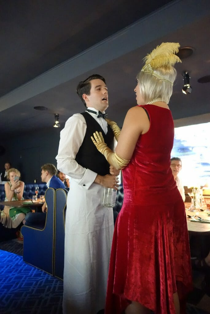 The waiter and Miss Tilly up close