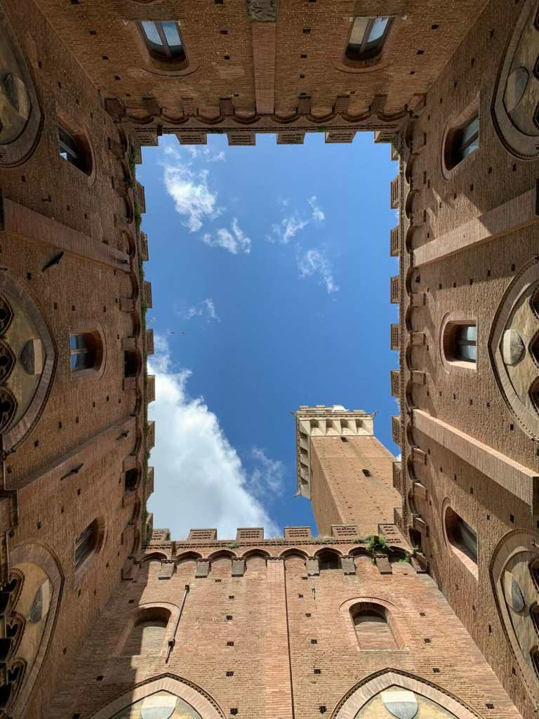 Looking up at the main tower in the Piazza del Campo, Siena