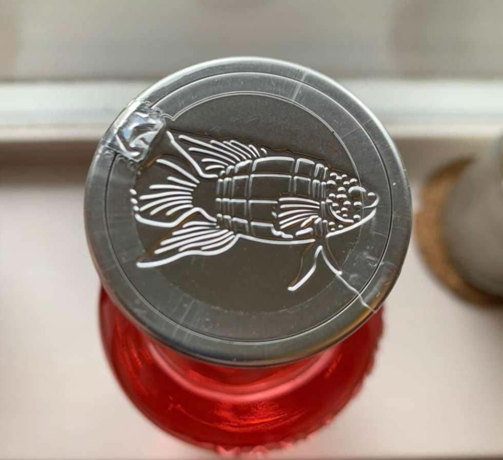 The Manly Spirits bottle stopper with fish logo on it