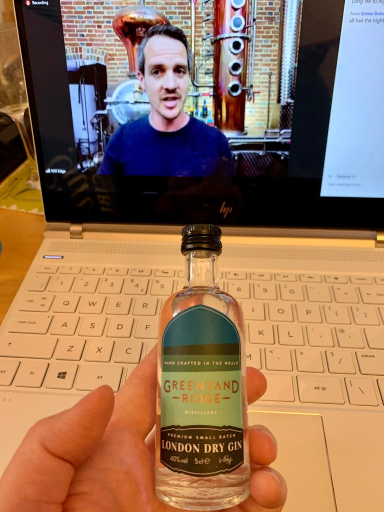 Will Edge from Greensands Ridge in front of his still on screen and mini tasting bottle of the gin in front