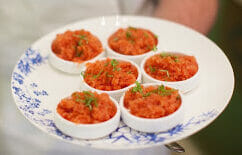 6 dishes of bloody mary granita on a plate