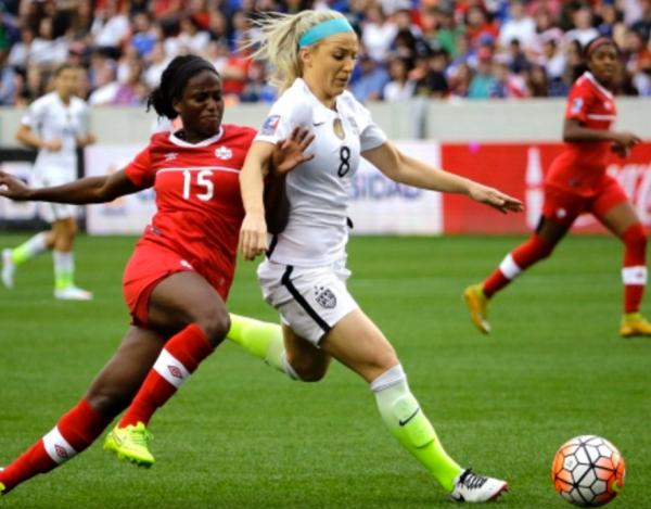 United States' Julie Johnston (8) keeps Canada's Nichelle Prince (15) from the ball during the first half of the CONCACAF Olympic women's soccer qualifying championship final. (AP Photo / David J. Phillip)