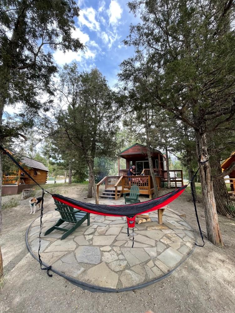camper cabin, hammock, and dog at koa campground in montana