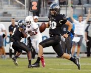 (AP Photo/John Raoux). Central Florida quarterback McKenzie Milton (10) runs for a 12-yard touchdown against Florida Atlantic during the first half of an NCAA college football game, Friday, Sept. 21, 2018, in Orlando, Fla.