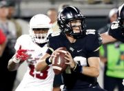 (AP Photo/John Raoux). Central Florida quarterback McKenzie Milton, right, looks for a receiver as he is pressured by Florida Atlantic defensive end Leighton McCarthy (13) during the first half of an NCAA college football game, Friday, Sept. 21, 2018, ...