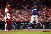 (AP Photo/Jeff Roberson). Milwaukee Brewers' Keon Broxton (23) scores past St. Louis Cardinals catcher Yadier Molina during the seventh inning of a baseball game Monday, Sept. 24, 2018, in St. Louis.
