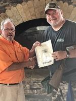 Local men capture sporting clays event