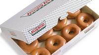Free Krispy Kreme doughnuts for graduates Tuesday. High school, college seniors just need to wear their caps and gowns.