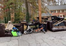Dunwoody house with tons of trash out front