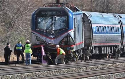 2 killed after Amtrak train hits backhoe, derails
