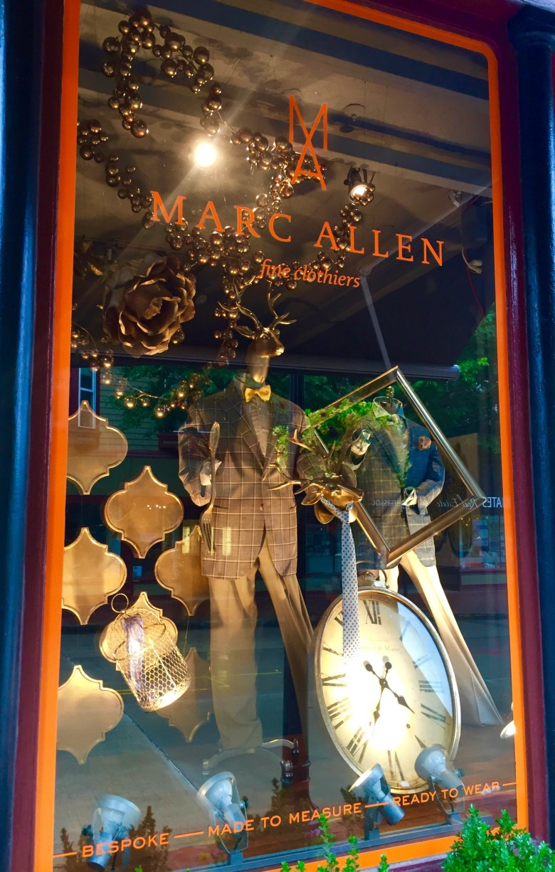 The window display at Marc Allen Fine Clothiers, located at 142 Bellevue Ave. in Newport lights up at night. The display was awarded 1st place in the Retail Window Display category at the 2016 Newport Flower Show.