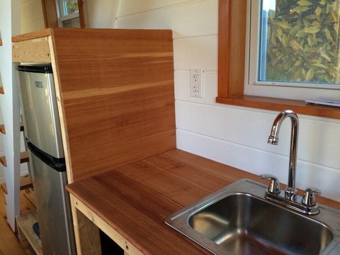 Sink, countertops, refrigerator.