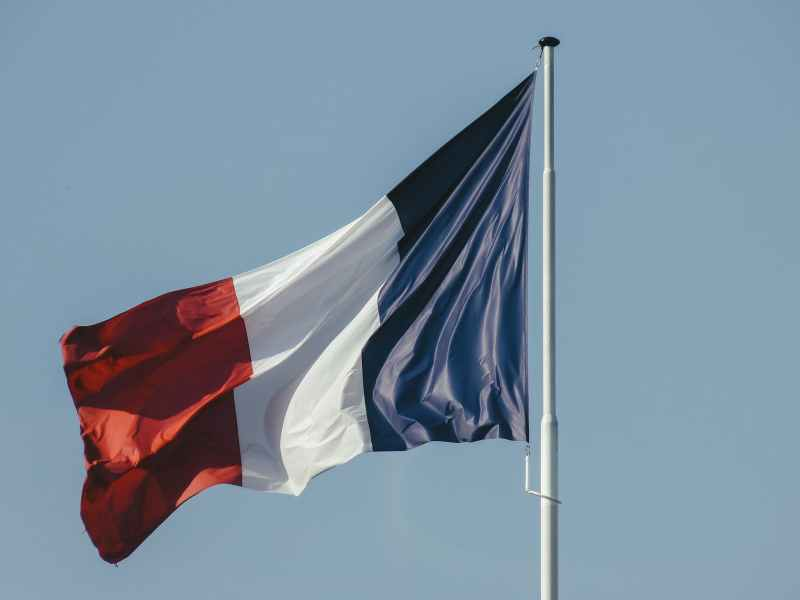 french flag against blue sky