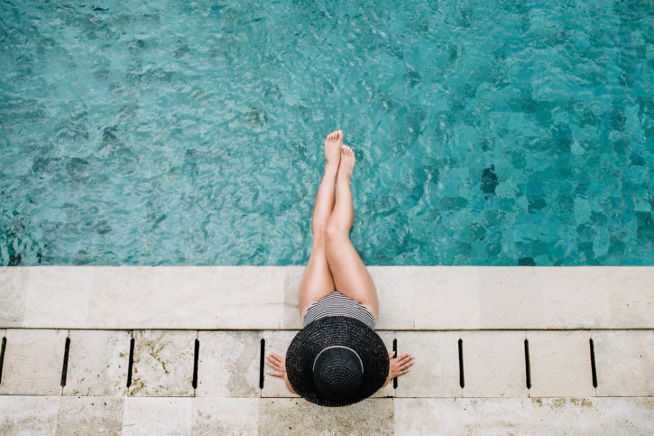 4 Summer Skincare Tips: Lady with hat