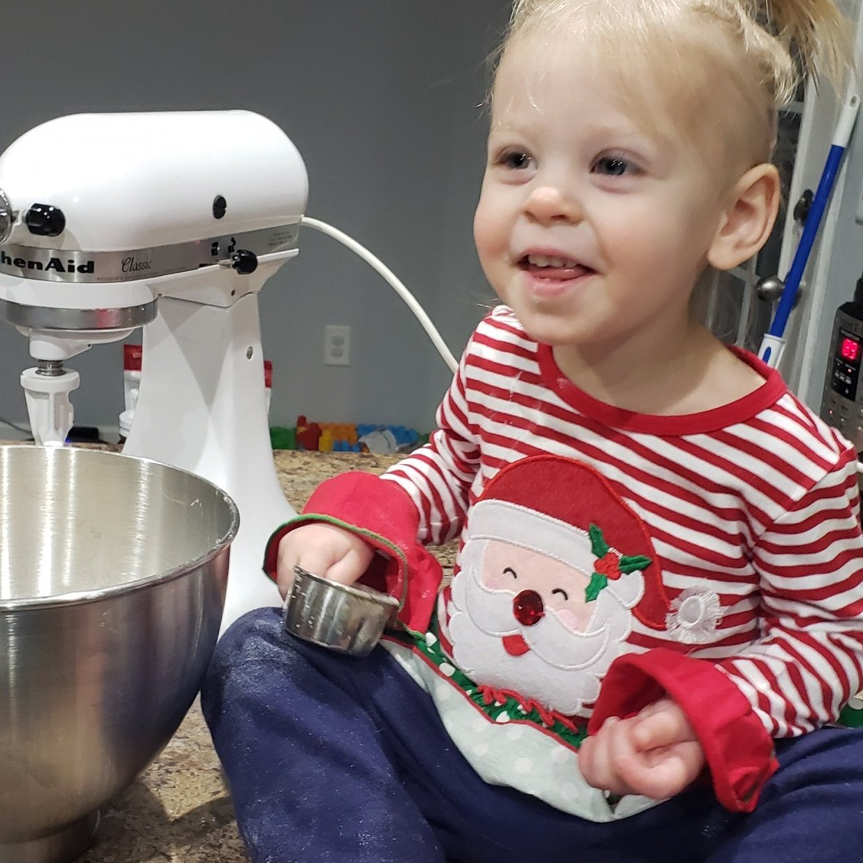 little girl making christmas cookies