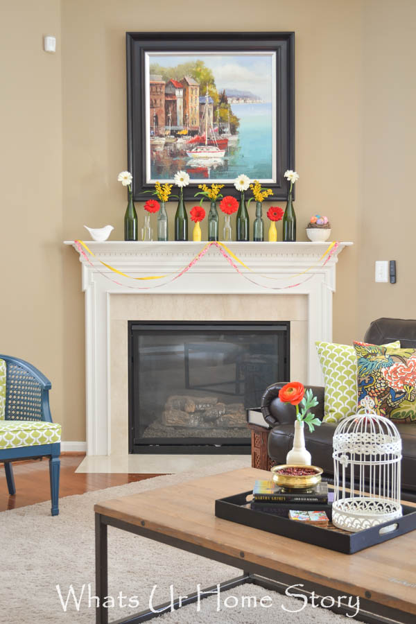 easy spring mantel with bottles as vases