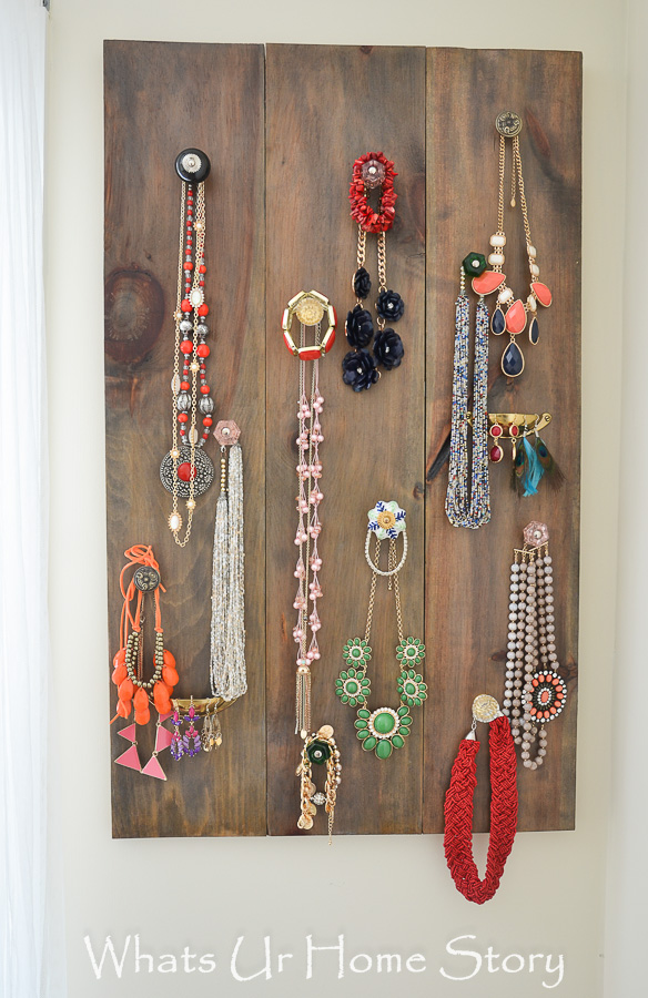 Use door knobs and pulls to organize your jewelry