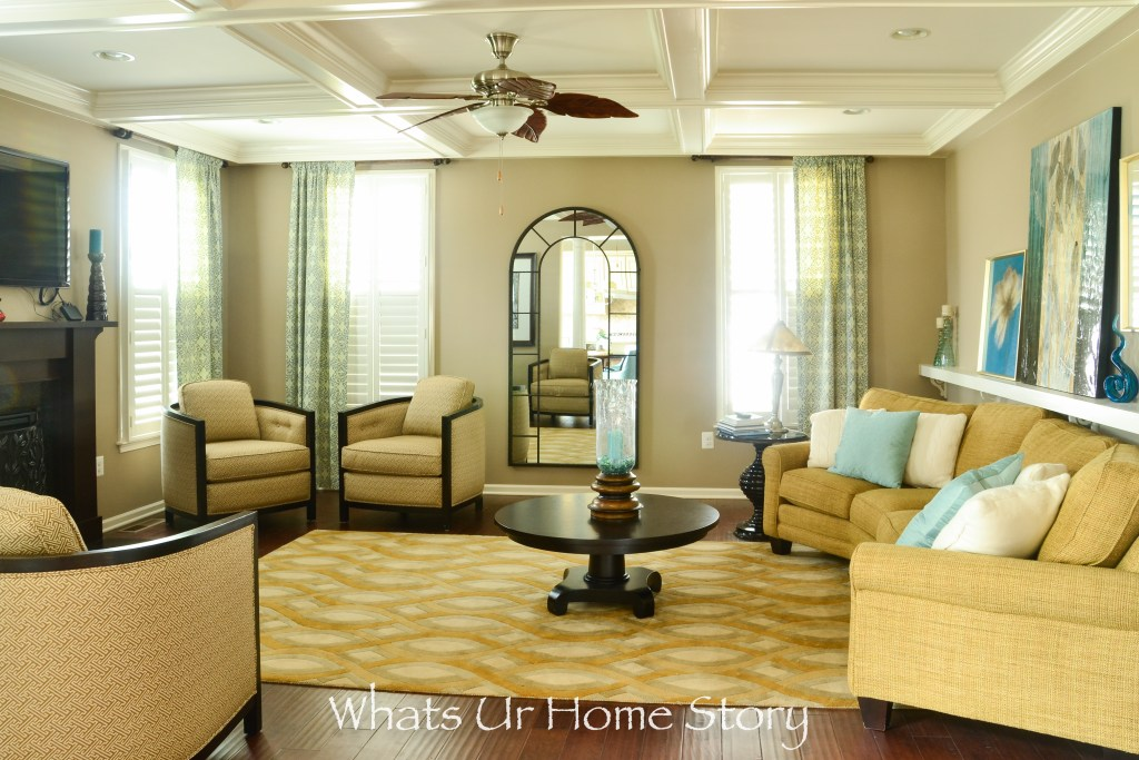 Neutral Family Room with blue accents_arch floor mirror