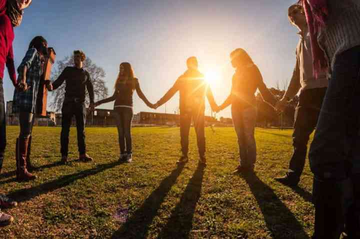 Multiracial Young People Holding Hands in a Circle