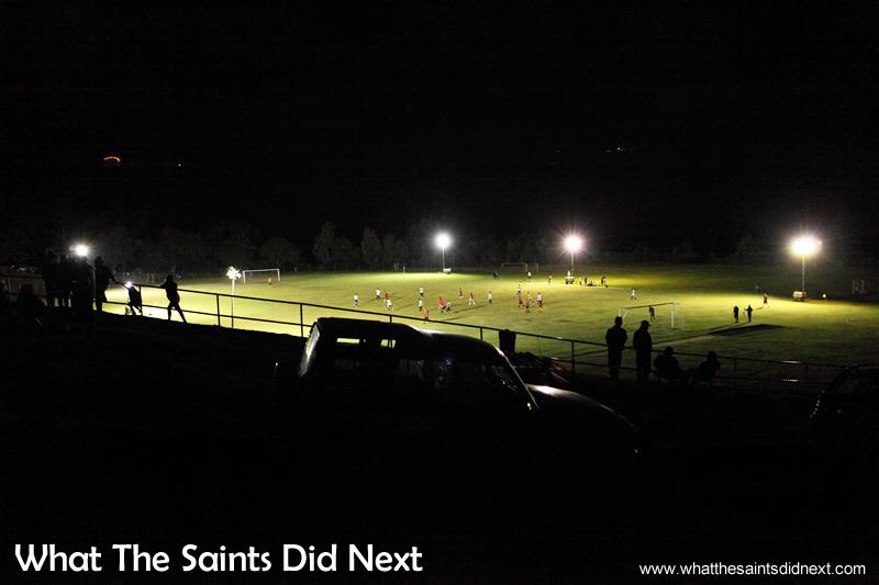 Football on St Helena under floodlighting.