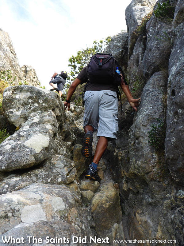 Darrin and Billy climbing up through the rocks. Hiking The Table Mountain National Park.