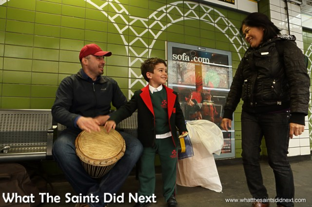 A young boy heads straight for the drum and much to his delight Dan lets him have a go.  Homeless Bucket Drum Busker Living On The Streets Of London.