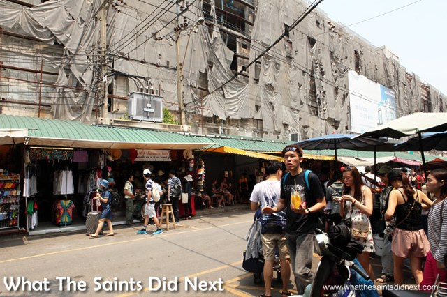 The 'Mad Max' building looks over the whole Bangkok street market park.