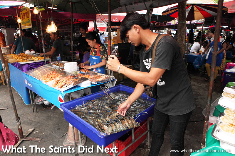 Chatuchak market food - Fresh shrimp are plucked from a tank for the grill while customers wait.