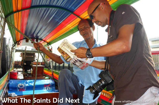 In deep conversation with our driver about what should be included on the tour. Bangkok Long Tail Boat Tour.