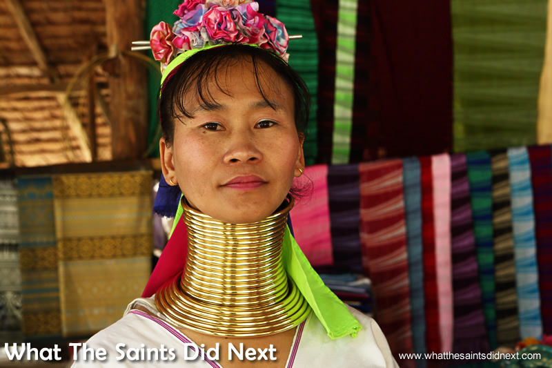 A Karen Long Neck Lady wearing the neck coils.