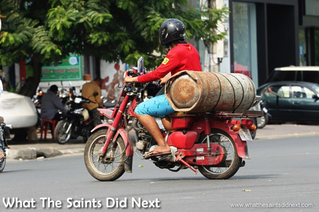 Health & Safety rules are little less strict here. Gas cylinders are whizzed about on mopeds quite easily. Watching Cambodia Traffic.
