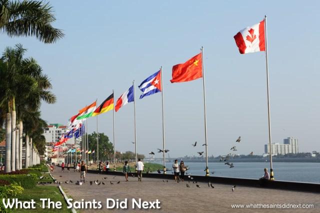 The international flags of the Riverside promenade.