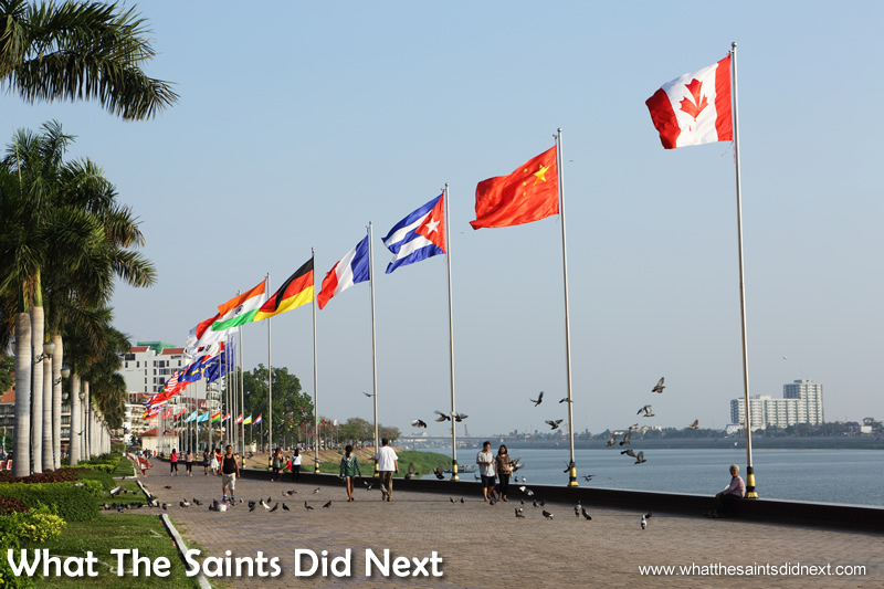 The international flags of the Riverside promenade. Walking the streets of Phnom Penh.