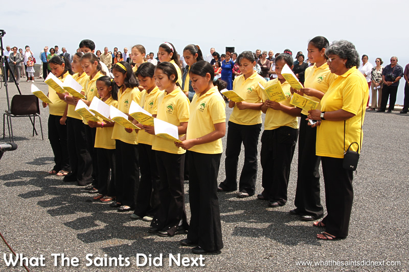 St Paul's Primary School pupils and students singing at an island event.