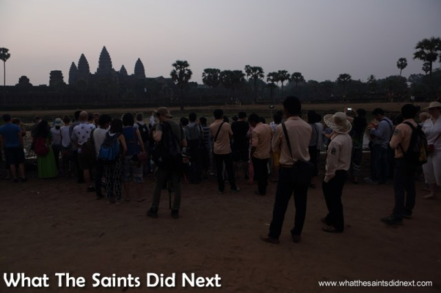 Even without a 'poolside' view, many people were happy to stand behind the crowd and wait. Watching an Angkor Wat sunrise.