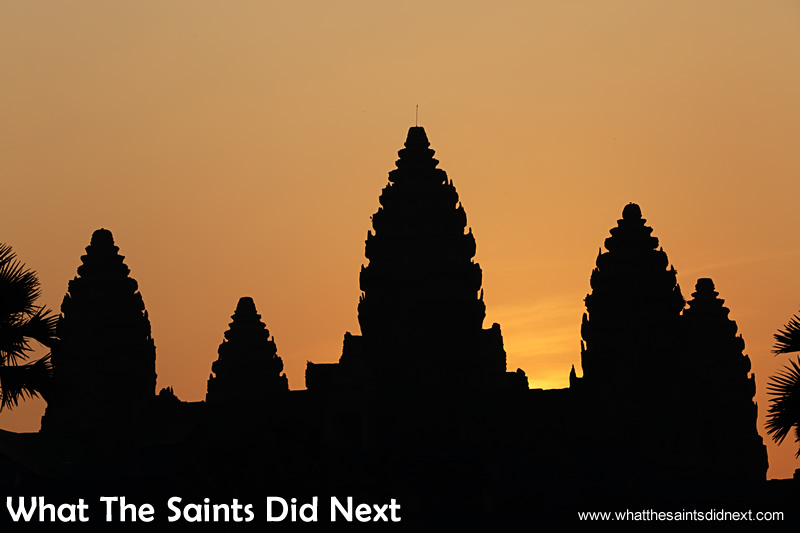 The sky begins to change colour and we know the sun won't be long now waiting for an Angkor Wat sunrise.