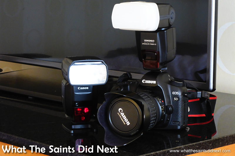 The Yongnou fitted on the camera and the Canon flash on its stand.