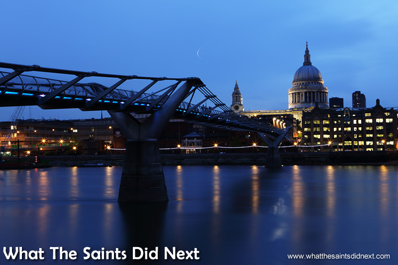 St Paul's Cathedral at night, at the end of the Millennium Bridge.