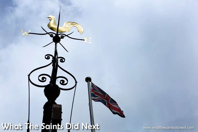 The weathervane on top of Carfax Tower catches a ray of sunlight.