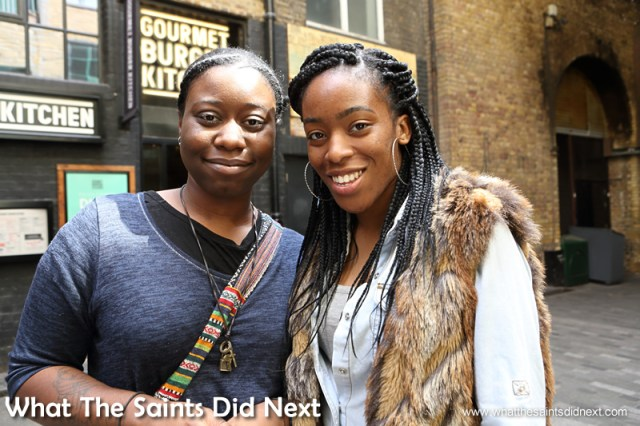 Esther and Oge.  Talking to people in London.