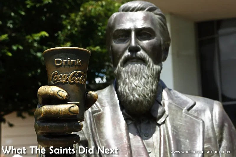The John Pemberton bronze statue at the front of the building acknowledges the inventor of Coca-Cola.  World of Coca-Cola Museum Atlanta