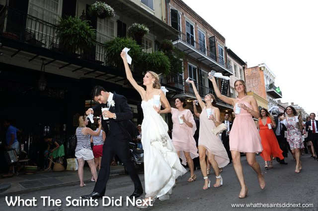 A second bridal party of the evening, on a march through the streets.