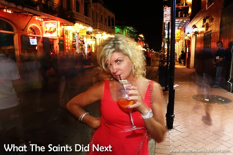 A happy reveller on Bourbon Street holds very still for her picture.