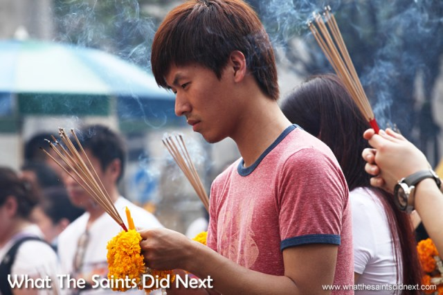 Worshippers burn incense as they offer prayers at the shrine.
