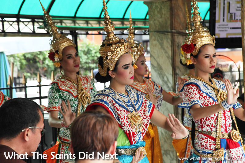 Thai dancers at the Erawan Shrine performing traditional dances.