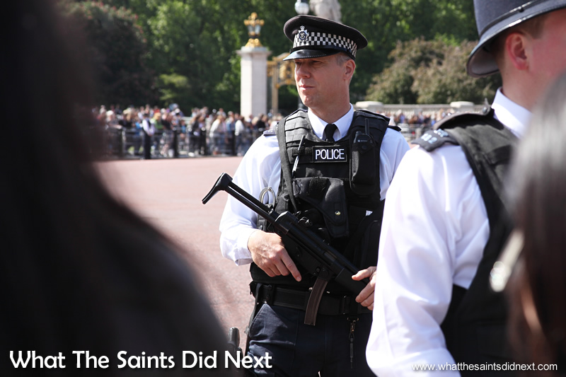 Armed police were on duty all along the route that the Queen's carriage would take.
